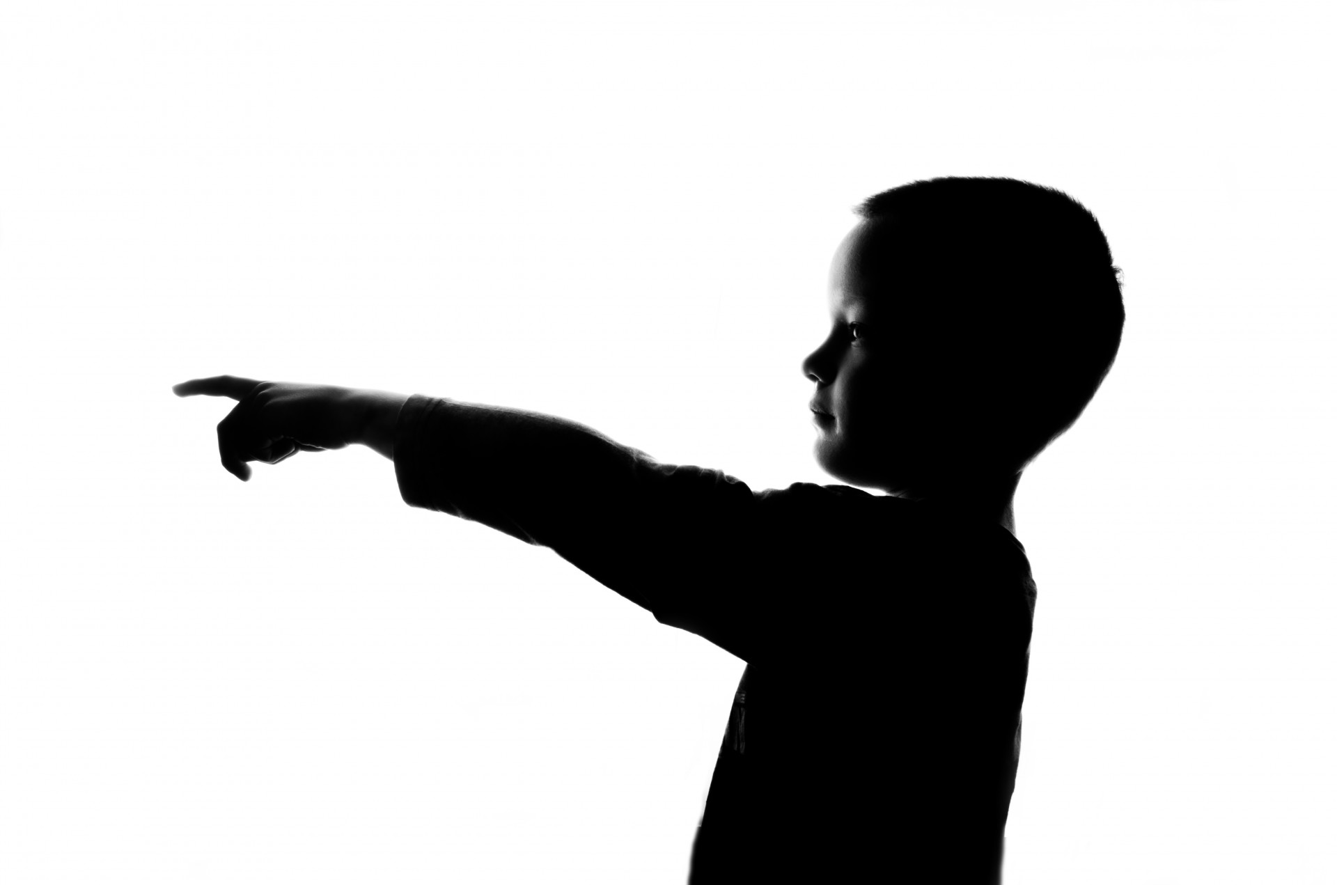 silhouette-boy-pointing-finger